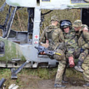 British Soldiers Help A Simulated Poster
