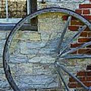 Broken Wagon Wheel Against The Wall Poster