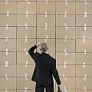 Businessman Facing A Cardboard Boxes Wall Poster by Sami Sarkis