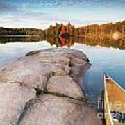 Canoe At A Rocky Shore Autumn Nature Scenery Poster