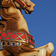 Carousel Horse Against Blue Sky Poster