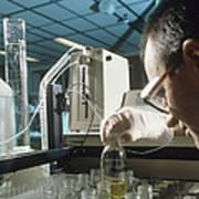 Chemist Analysing Fluids For Pesticide Pollutants Poster