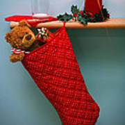 Christmas Stocking Filled With Presents With Empty Milk Glass.  Poster