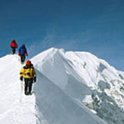 Climbers Hike Along A Ridge Poster