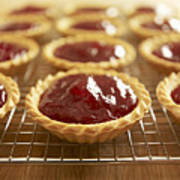 Close Up Of Jam Tarts Cooling On Wire Rack Poster