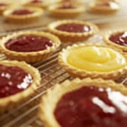 Close Up Of Jam Tarts Cooling On Wire Racks Poster