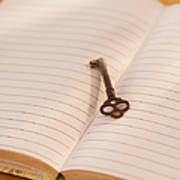 Close Up Of Open Notebook With Key, Studio Shot Poster