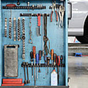 Closeup Of A Variety Of Tools On A Blue Poster by Corepics