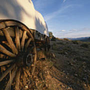 Covered Wagon At Bar 10 Ranch Poster by Todd Gipstein