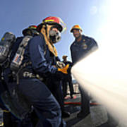 Damage Controlmen Conduct Fire Hose Poster
