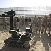 Demonstration Of A Bomb Disposal Robot Poster