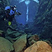 Dry Suit Divers In Gin Clear Waters Poster