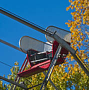 Empty Chair On Ferris Wheel Poster by Thom Gourley/Flatbread Images, LLC