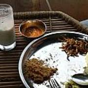 Enjoying A Plate Of Rajasthani Food On A Steel Plate On A Bamboo Table Poster