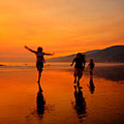 Family Running In The Beach At Sunset Poster