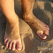 Feet Of A Child In The Sand Poster