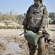 Female Airman Carries A Sandbag Poster