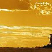Field With Combine At Sunset Poster