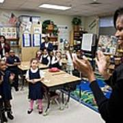 First Lady Michelle Obama Claps Poster by Everett