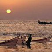 Fishermen Holding Nets In Sea At Sunset Poster
