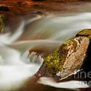 Flowing River Blurred Through Rocks Poster