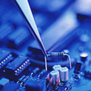 Forceps Holding A Resistor Over A Circuit Board Poster