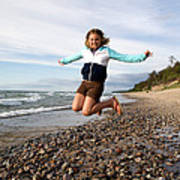 Girl Jumping At Lake Superior Shore Poster