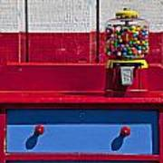 Gum Ball Machine On Red Desk Poster