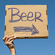 Hand Holding Up Makeshift 'beer' Sign Poster