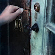 Hand Putting Vintage Key Into Lock Poster
