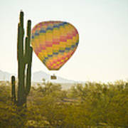 Hot Air Balloon Over The Arizona Desert With Giant Saguaro Cactu Poster
