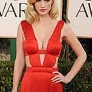 January Jones Wearing A Versace Dress Poster by Everett