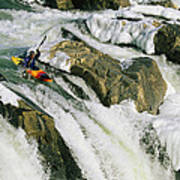 Kayaker At The Top Of A Waterfall Poster