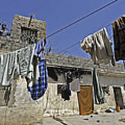 Laundry Hangs In The Courtyard Poster by Stocktrek Images