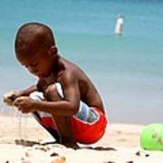 Little Boy Playing With Sand On The Beach Poster