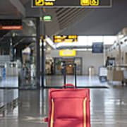 Luggage Sitting Alone In An Airport Terminal Poster
