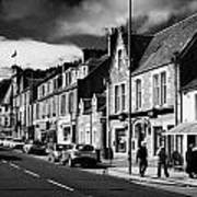 main road through the picturesque small town of Callander scotland uk Poster by Joe Fox