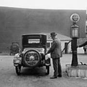 Man Fueling His Car At A Self-service Poster