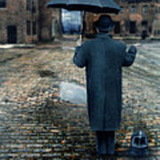 Man In Vintage Clothing With Umbrella On Rainy Brick Street Poster