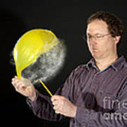 Man Popping A Balloon Poster