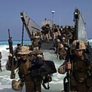 Marines Disembark A Landing Craft Poster