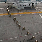 Marines Embark A Ch-46e Sea Stallion Poster