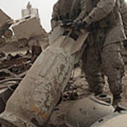 Marines Lift Up A Bomb To Determine If Poster