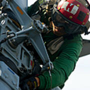 Mechanic Inspects An Mh-60r Sea Hawk Poster
