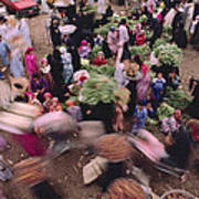 Merchants At Saqqaras Market Carry Poster