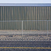 Metal Storage Shed Behind Fence Poster