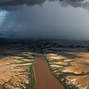 Monsoon Rains Over A Muddy River Poster by Randy Olson