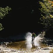 Mountain Biker Splashing Through Water Poster