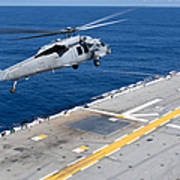 N Mh-60s Sea Hawk Helicopter Lifts Poster