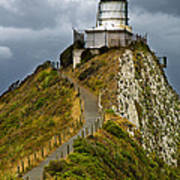 Nugget Point Light House And Dark Clouds In The Sky Poster
